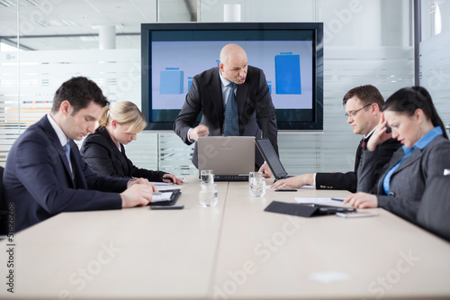 Manager yelling at his employees at the meeting. Company is in r