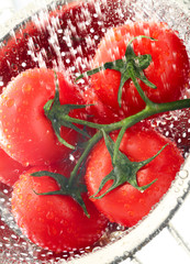 Tomatoes-on-vine-water-splash