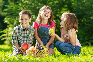 Three happy smiling child playing in park