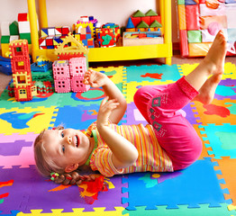 Child  playing with building block .