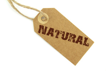 """ Natural "" text stamp on a label with natural paper and rope"