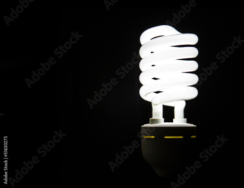 Light Bulb Over Black Background