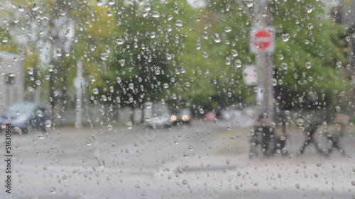 Rainy day inside car. Passing traffic.