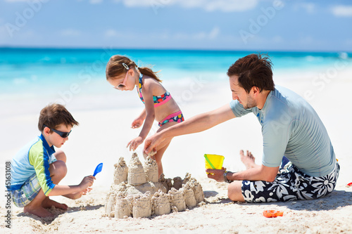 Father and kids playing at beach
