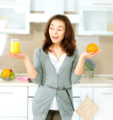 Funny Woman Choosing between Orange Juice or Whole Orange