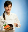 female chef with frozen seafood