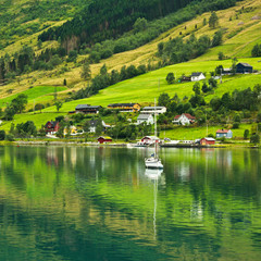 Rural landscape with yacht  in Olden, Norway.