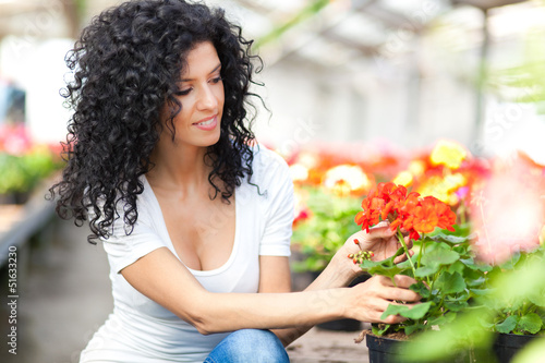 Young female florist in a greenhouse