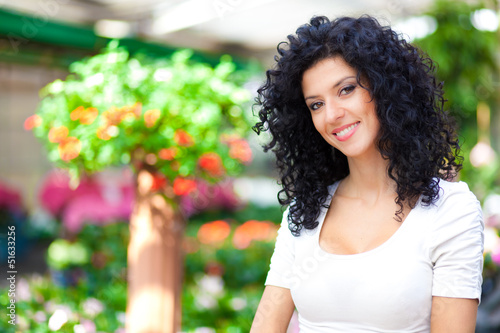 Smiling florist in a greenhouse