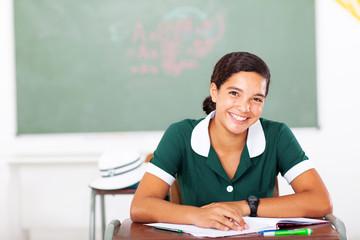 high school girl sitting in classroom