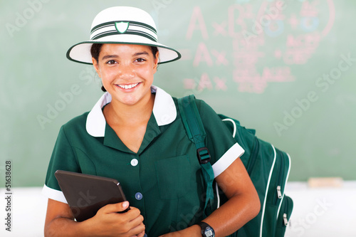 cheerful teen school girl holding tablet computer