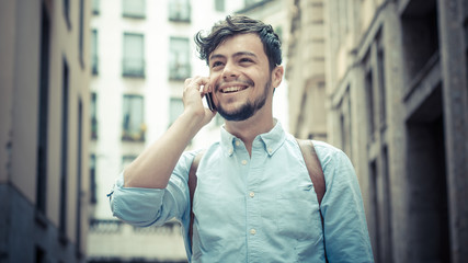 stylish man in the street at the phone