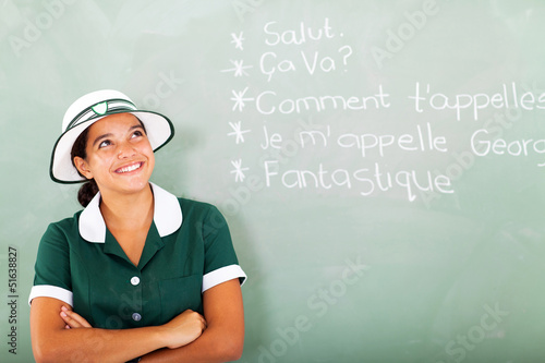 female high school student learning french