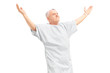 A happy mature patient gesturing happiness with raised hands