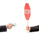 Man with a stop sign saying no to bribery