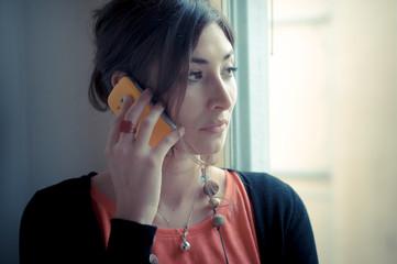 beautiful woman at home at the phone