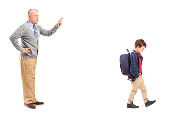Full length portrait of a grandfather reprimanding a little boy