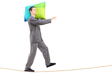 Full length portrait of a man sleepwalking on a rope
