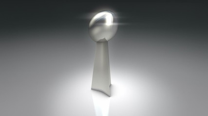 Pro football silver trophy rotating around in circle