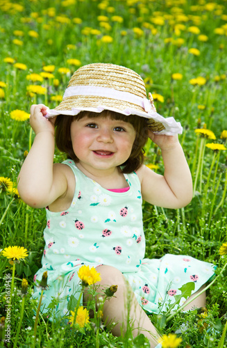 Happy girl on the meadow with white flowers