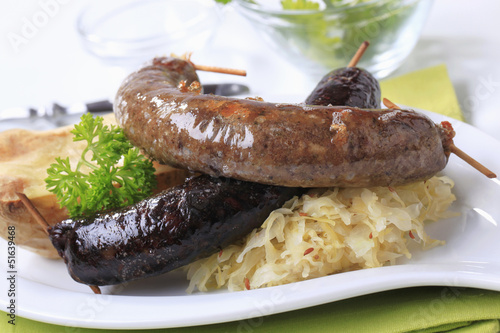 Sausages, sauerkraut and baked potato