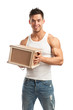 Muscular young man holding parcel