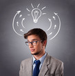 Young man thinking with arrows and light bulb overhead
