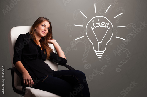 Young girl comming up with a light bubl idea sign