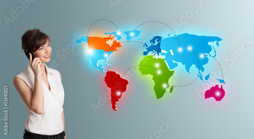 young woman making phone call with colorful world map