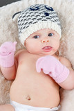 Baby with tuque and mittens