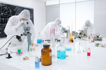 people analysing chemical reactions in a lab