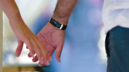 Man and woman holding hands. Close-up