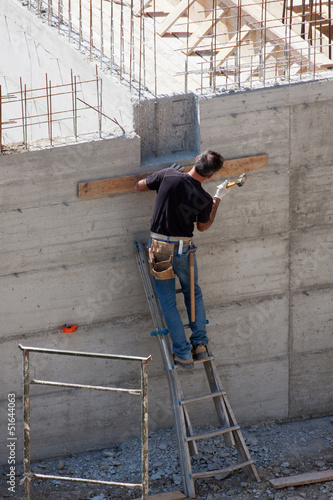 Carpenter at work on building yard