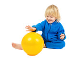 Cute baby boy plays with yellow ball