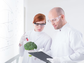 researchers injecting broccoli