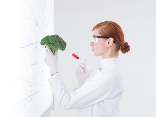 scientist injecting a broccoli