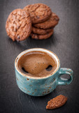Cup of coffee and chocolate cookies with chocolate chips