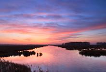 Tranquil riverside sunrise