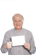 Senior man holding a blank card