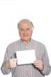 Senior man holding a blank card