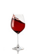 Splash of red wine in a glass