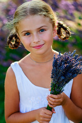Herbal garden - lovely girl with bunch of lavender flowers