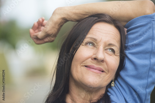 Happy smiling relaxed mature woman