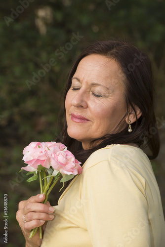 Mature Woman in love with rose