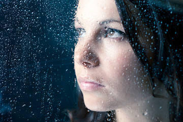 Woman On Window In The Rain