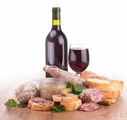 composition with wine,meat spread and sausages