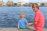 family sitting on pier in Stockholm