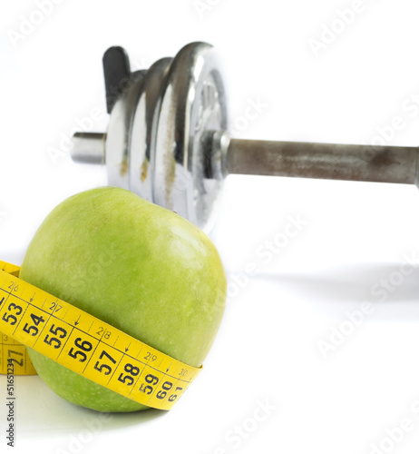 apple, tape and dumbbell
