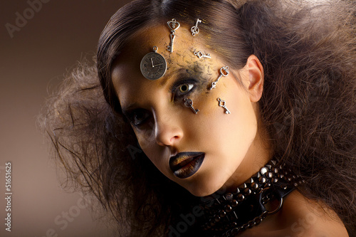 Artistry. Shiny Woman in Shadows. Golden Makeup. Creativity
