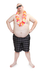Obese traveler with hawaian flowers.